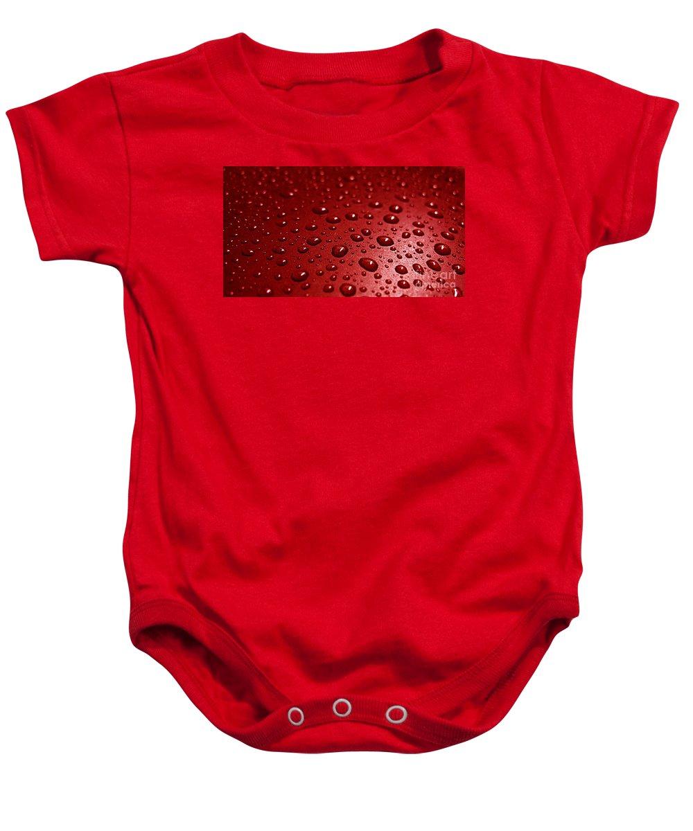 Bubble Baby Onesie featuring the photograph Rain Drops Bloody Red by Ausra Huntington nee Paulauskaite