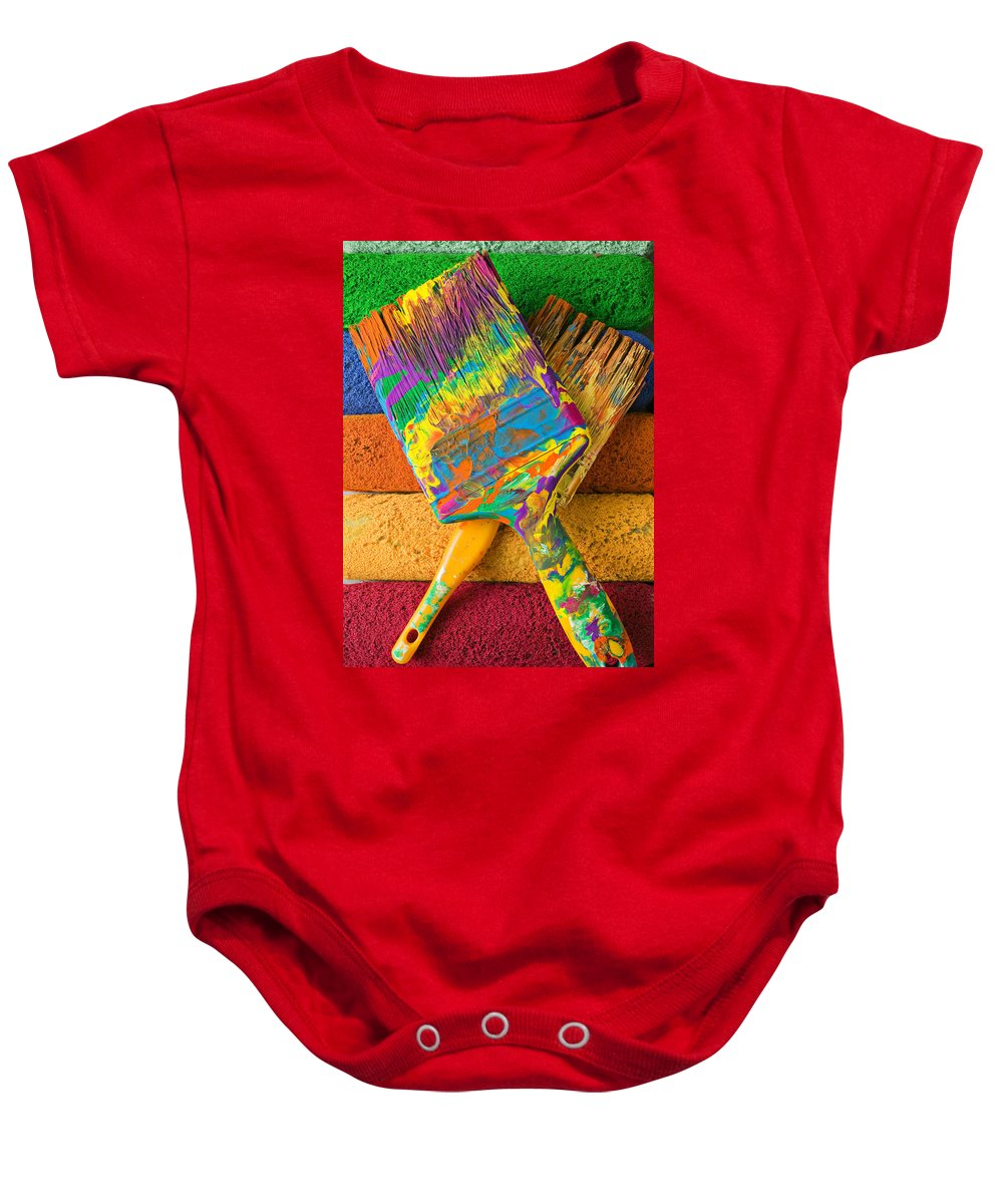 Paint Baby Onesie featuring the photograph Two Paintbrushes On Paint Rollers by Garry Gay