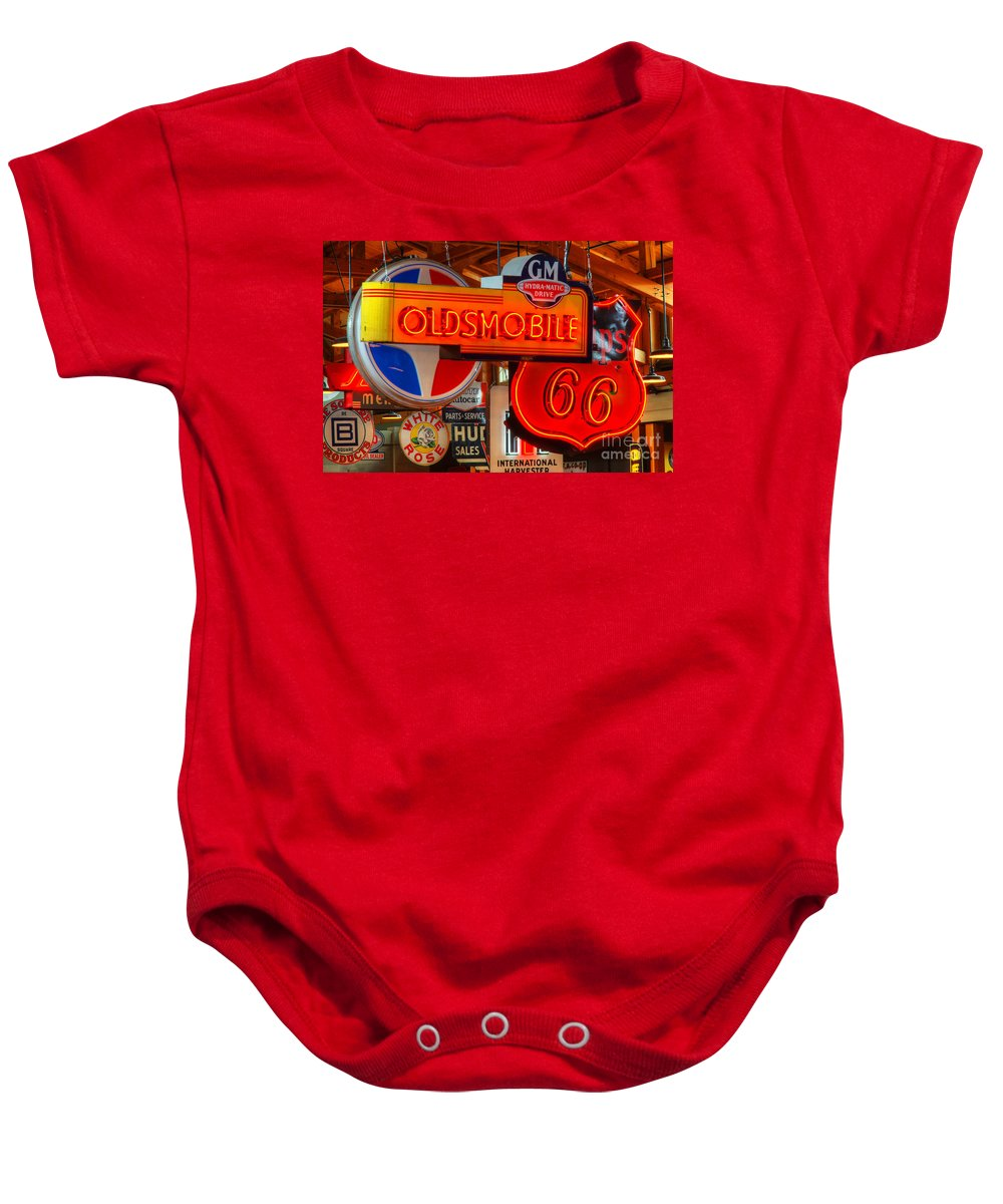 Classic Signs Baby Onesie featuring the photograph Vintage Neon Sign Oldsmobile by Bob Christopher