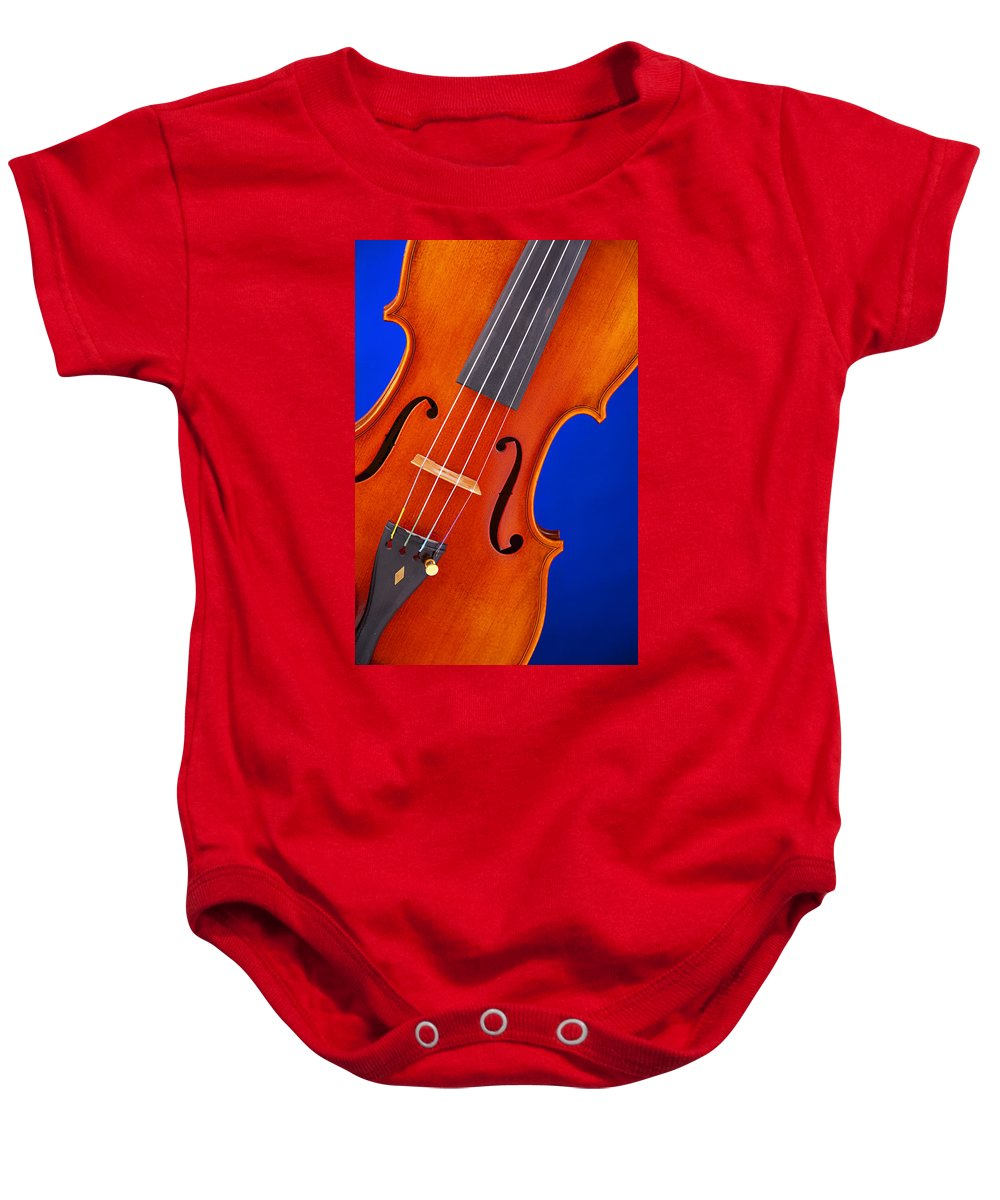 Violin Baby Onesie featuring the photograph Violin Isolated On Blue by M K Miller