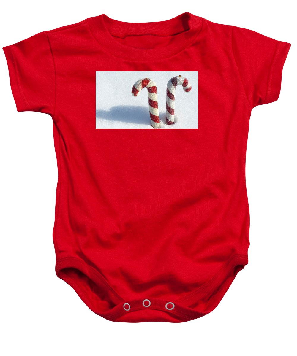 Christmas Baby Onesie featuring the photograph Christmas Candy Canes On Real Snow by Isabelle Haynes