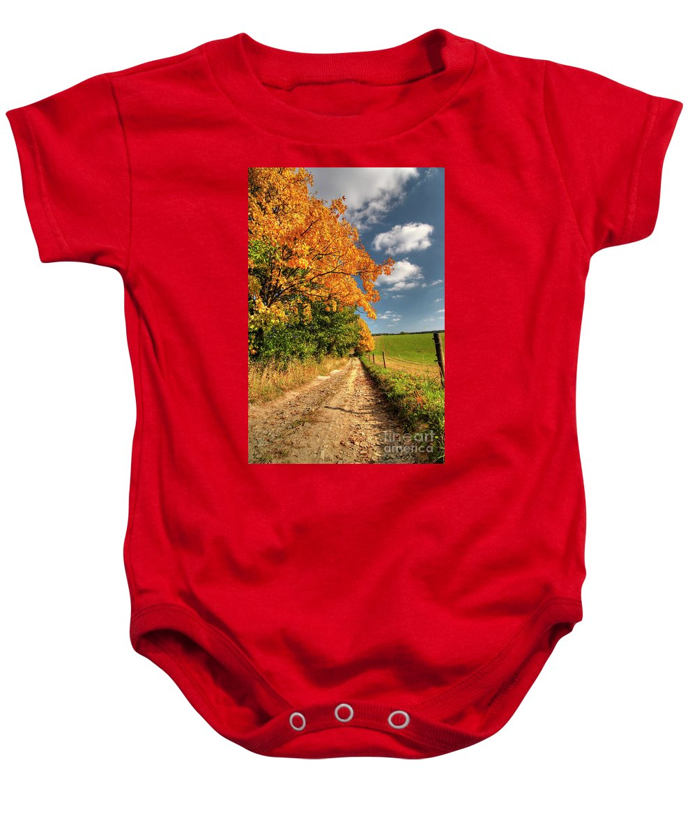 Autumn Baby Onesie featuring the photograph Country Road And Autumn Landscape by Michal Boubin