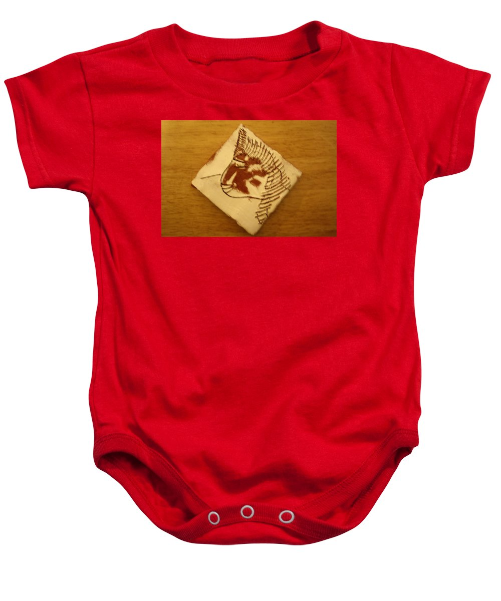 Jesus Baby Onesie featuring the ceramic art Jane - Tile by Gloria Ssali