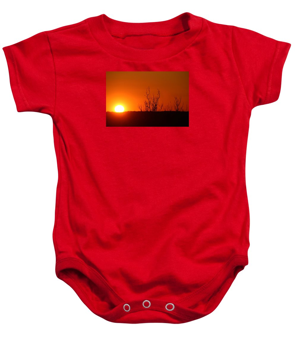 Sun Set Baby Onesie featuring the photograph Sunsets by Donn Ingemie