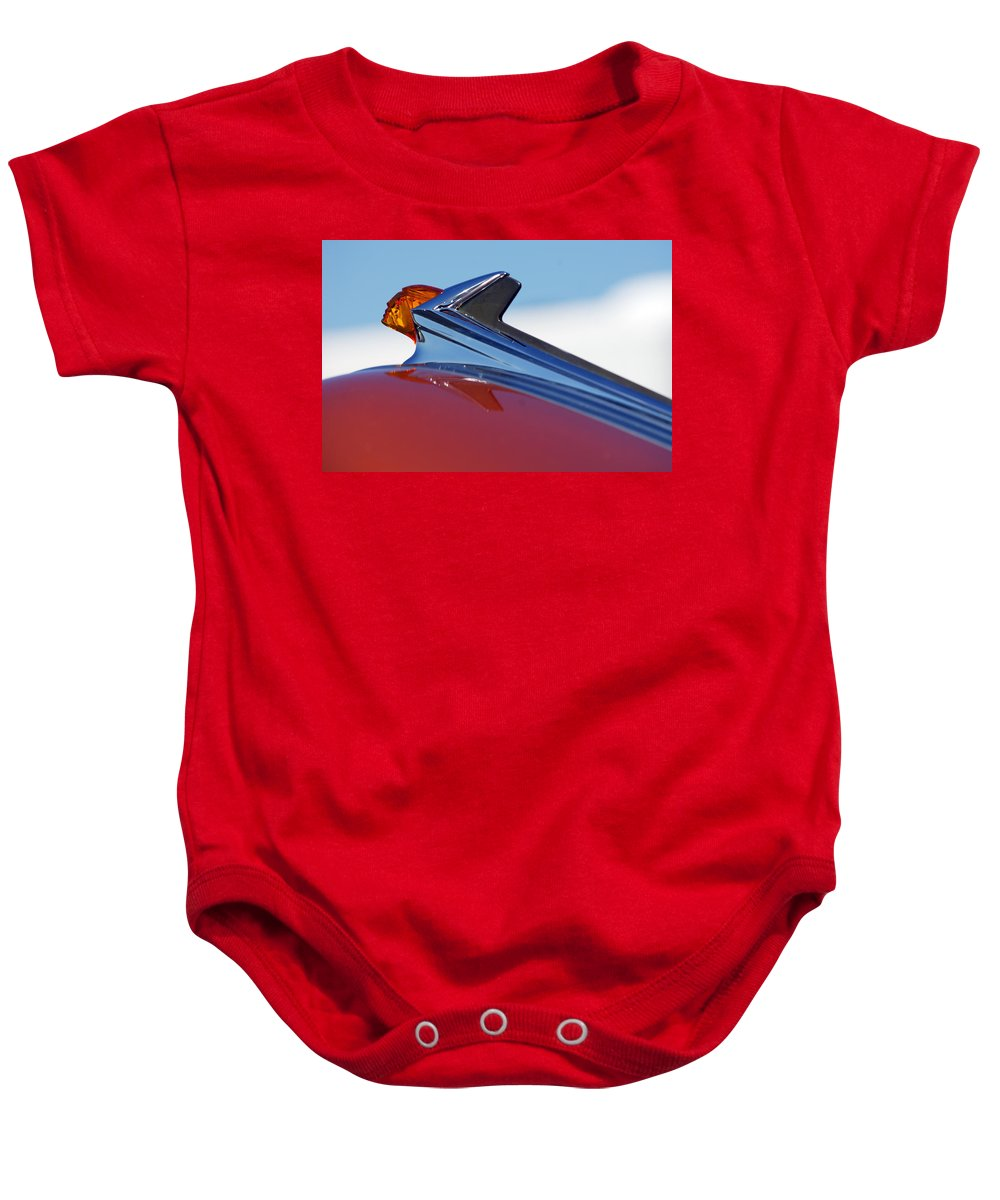 Car Baby Onesie featuring the photograph 1952 Pontiac Tin Woodie Wagon Hood Ornament by Jill Reger