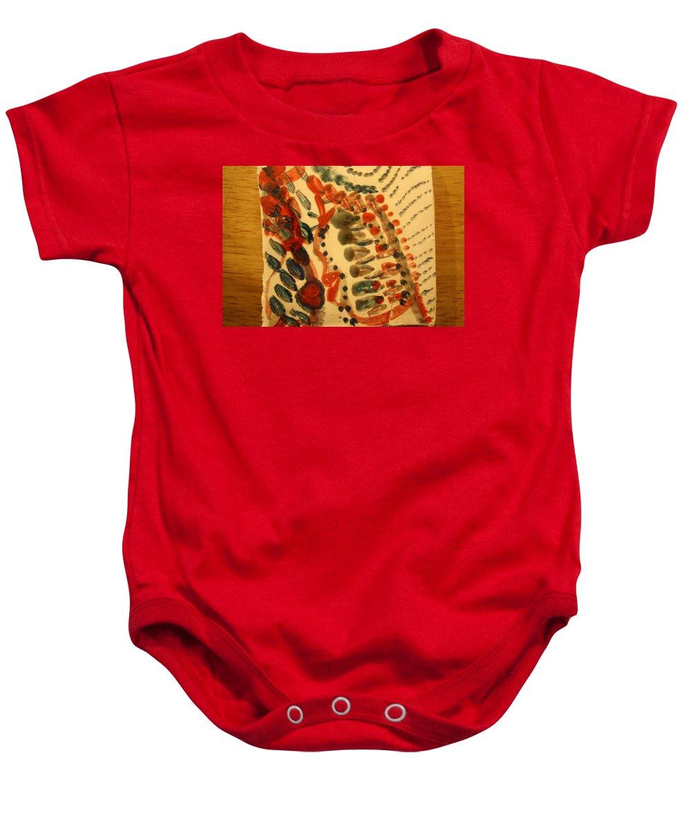 Jesus Baby Onesie featuring the ceramic art Joy - Tile by Gloria Ssali