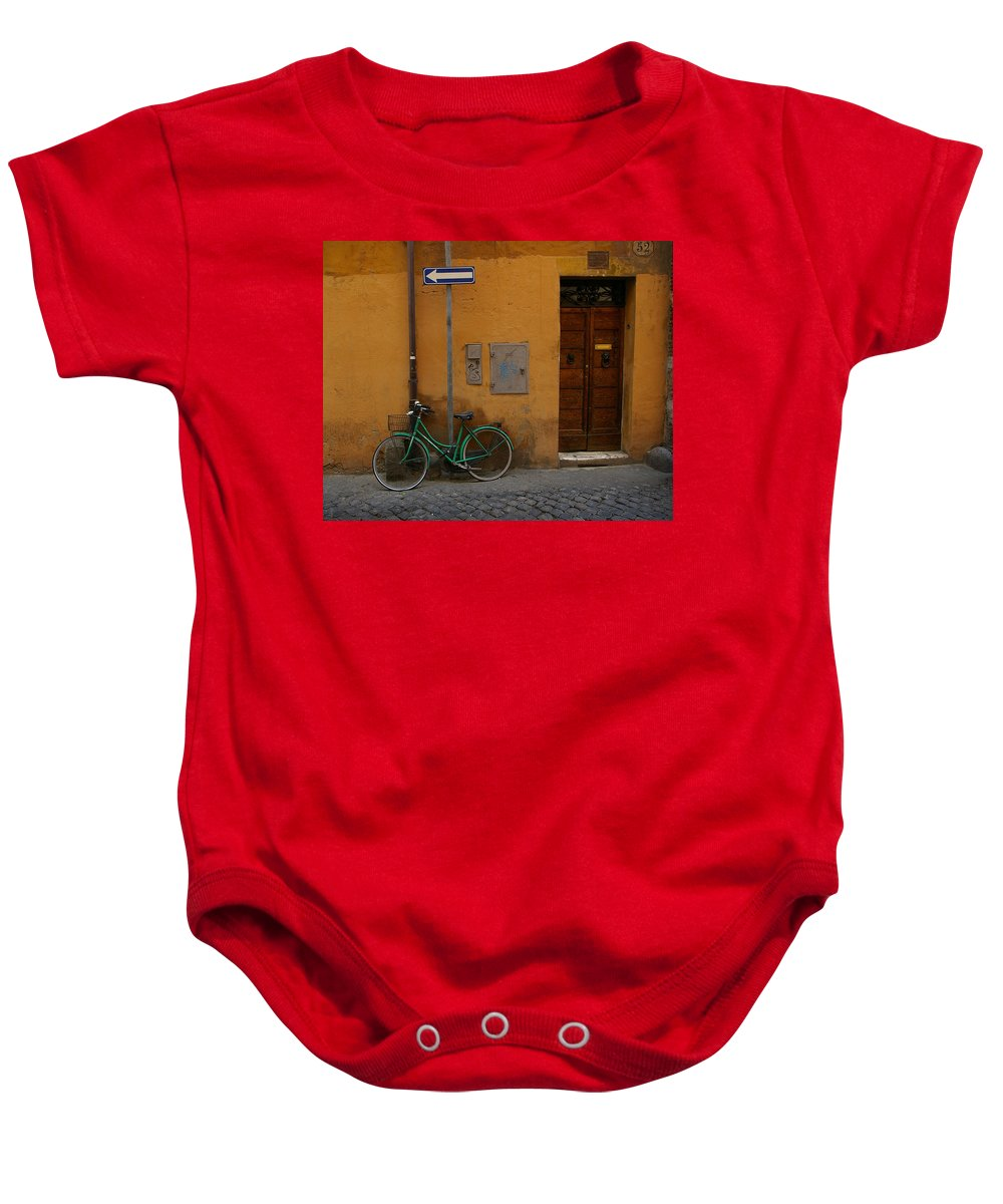 Bike Baby Onesie featuring the photograph A Bike In Rome by Tom Reynen