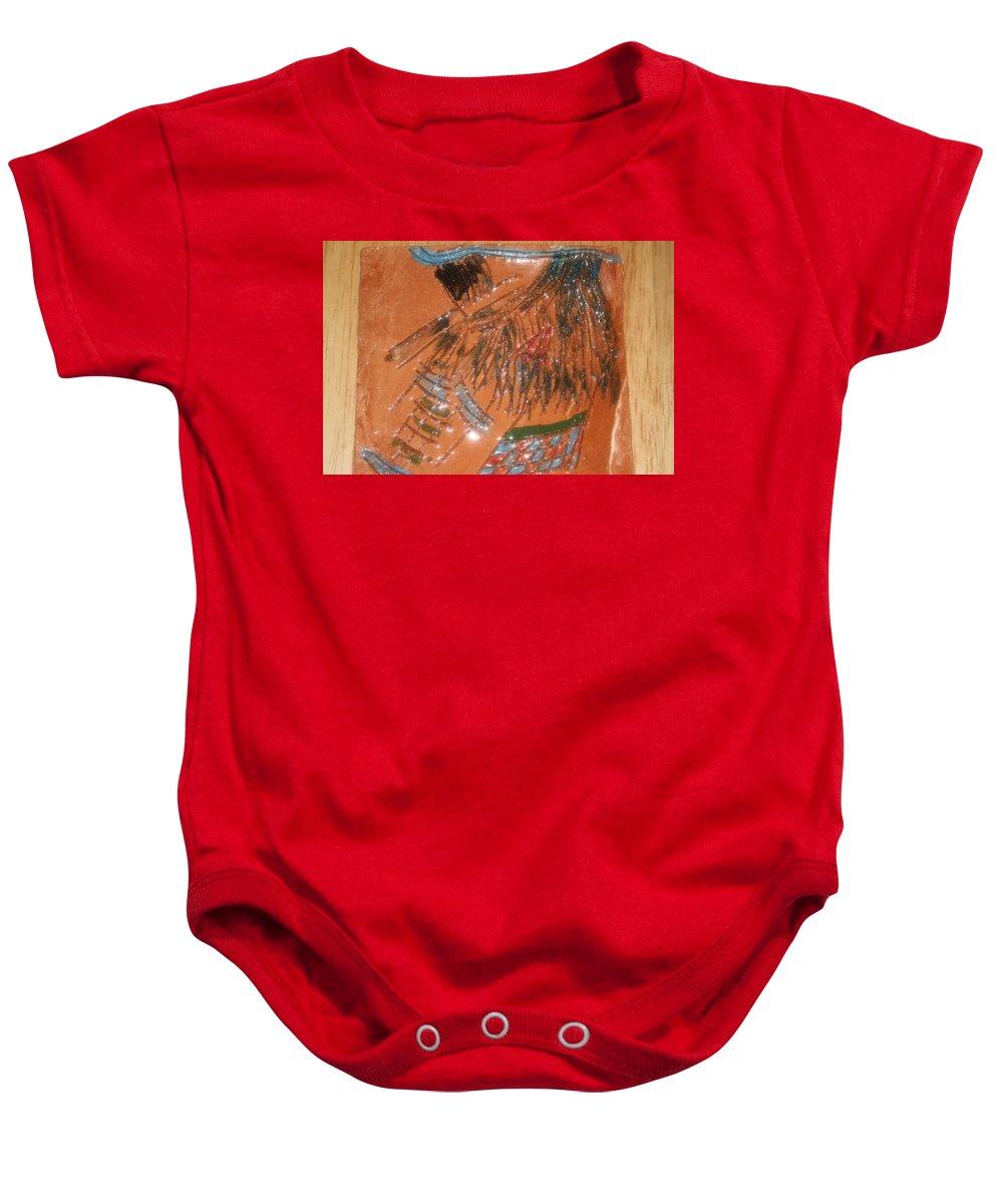 Jesus Baby Onesie featuring the ceramic art Alicia - Tile by Gloria Ssali