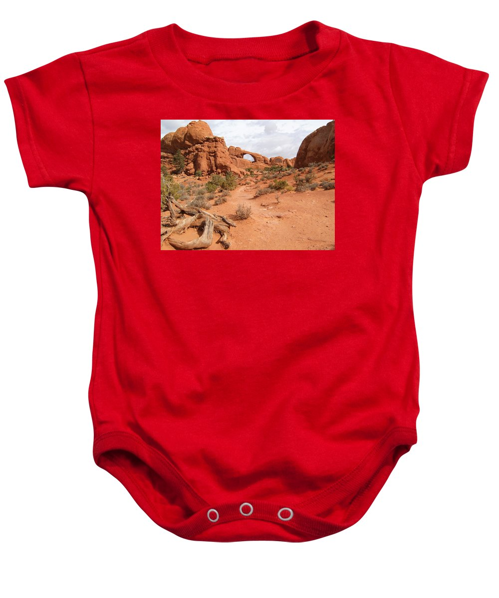 National Parks Baby Onesie featuring the photograph Arches With Wood by Marvin Averett