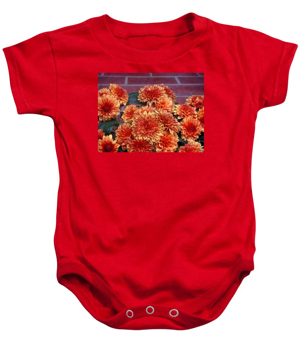 Nature Baby Onesie featuring the photograph Autumn Mums - Against Brick by Lucyna A M Green
