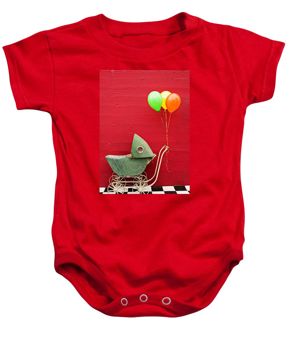 Baby Buggy Baby Onesie featuring the photograph Baby Buggy With Red Wall by Garry Gay