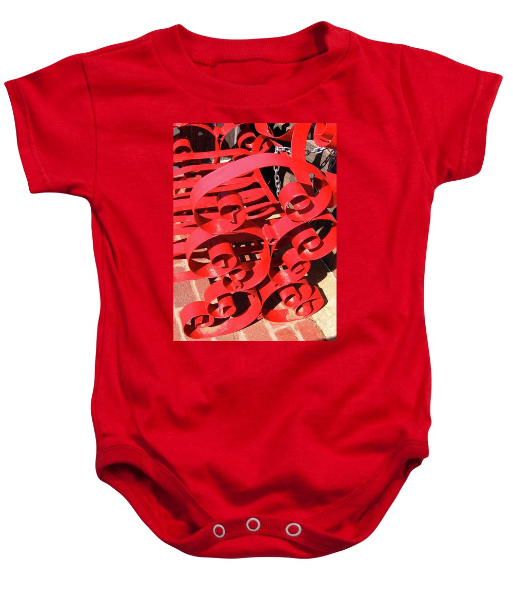 Red Baby Onesie featuring the photograph Chair Spiral by Denise Keegan Frawley