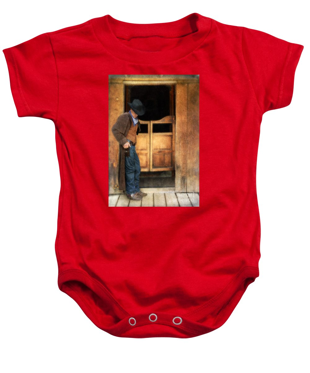Cowboy Boots Baby Onesie featuring the photograph Cowboy By Saloon Doors by Jill Battaglia