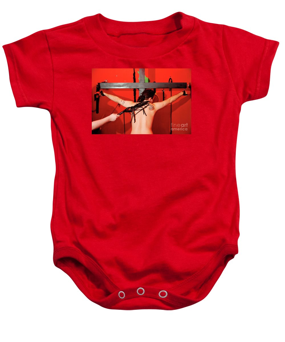 Tattoo Baby Onesie featuring the photograph Crucified Young Man In A Bdsm Dungeon 7 by Ilan Rosen