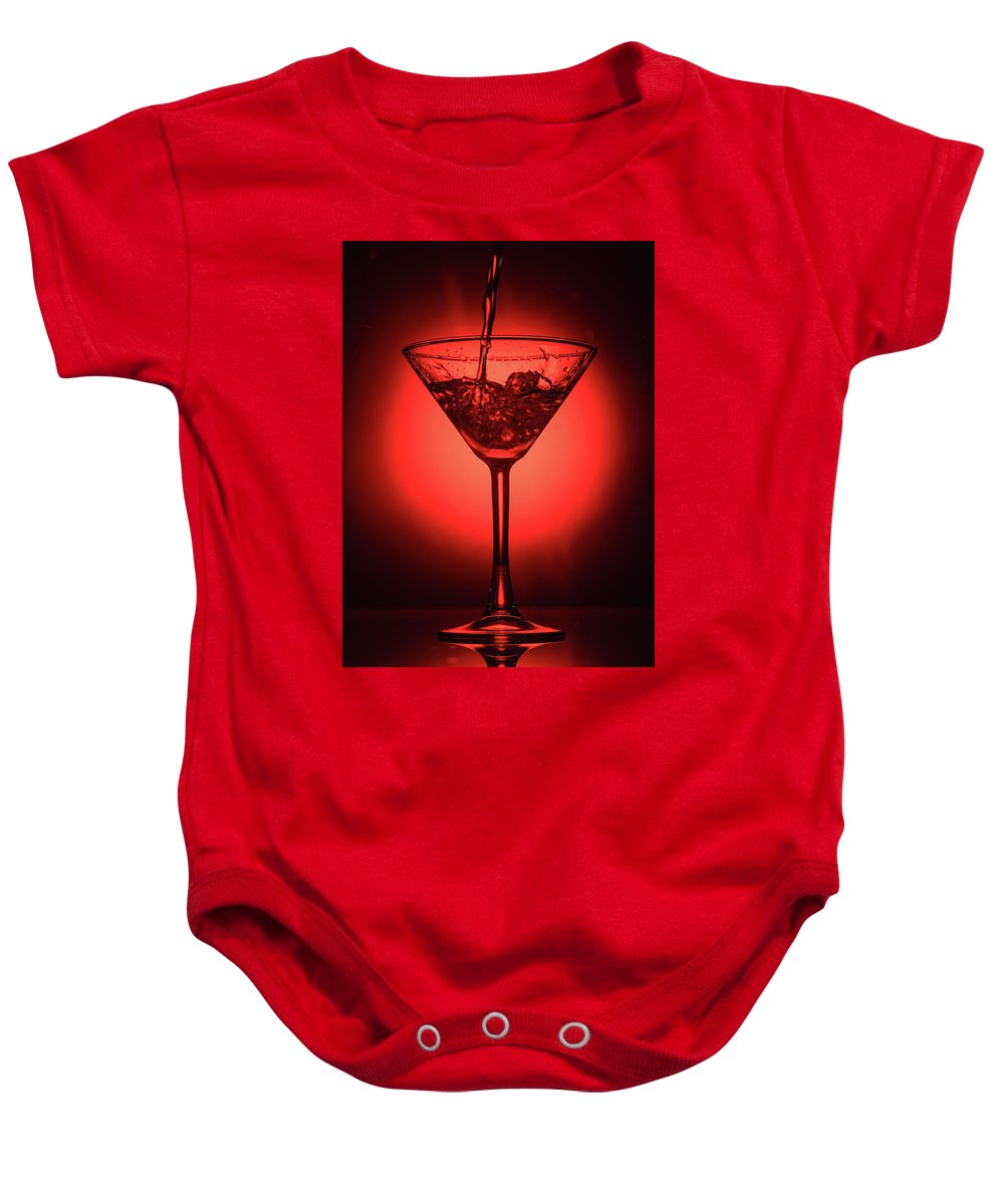 Alcohol Baby Onesie featuring the photograph Empty Cocktail Glass On Red Background by Oleg Yermolov