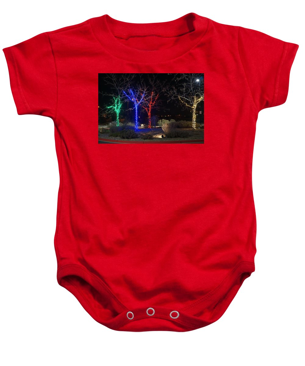 Winter Baby Onesie featuring the photograph Four Lighted Trees by Susan Brown