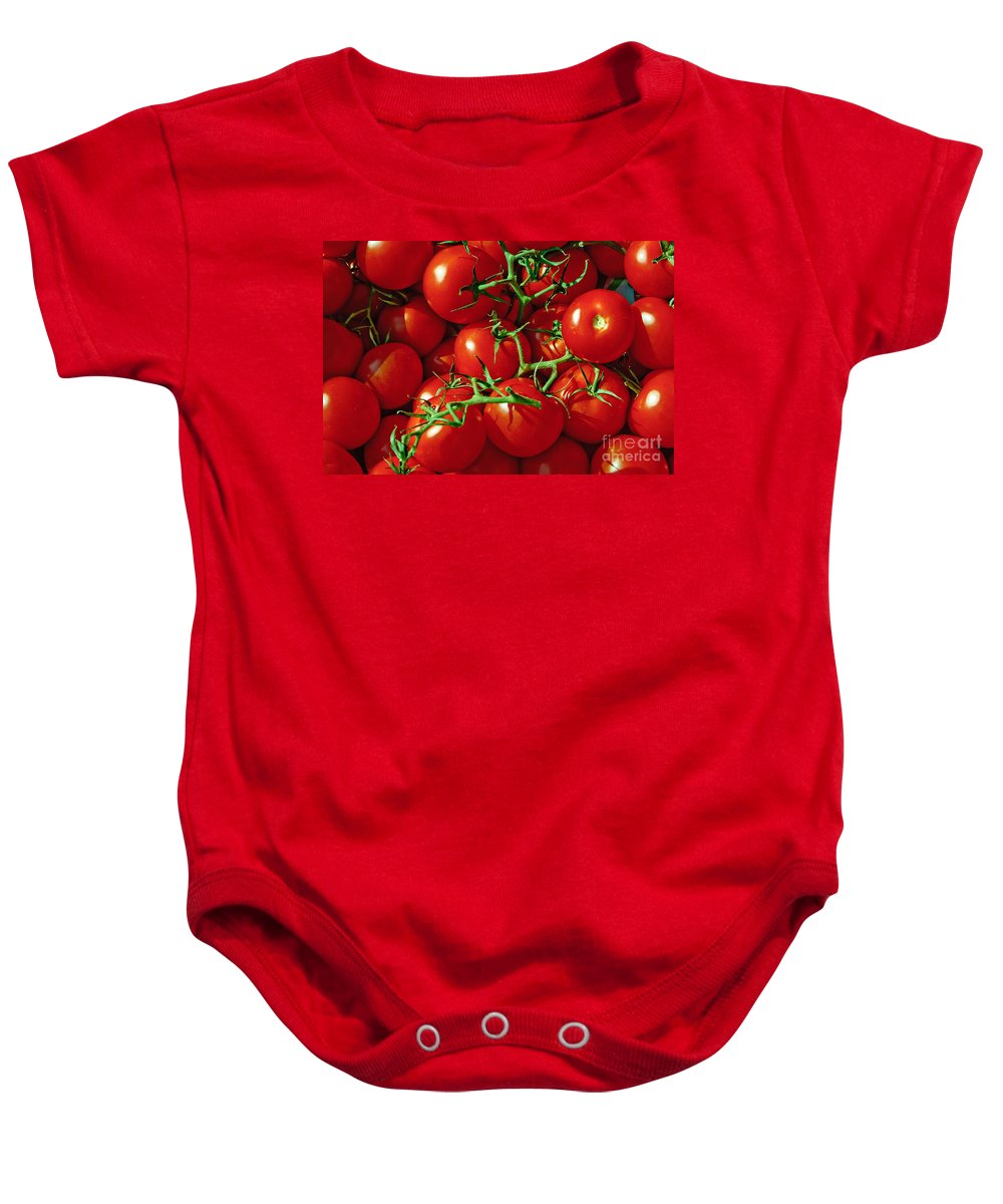 Tomato Baby Onesie featuring the photograph Fresh Tomotos On The Vine by Thomas Marchessault
