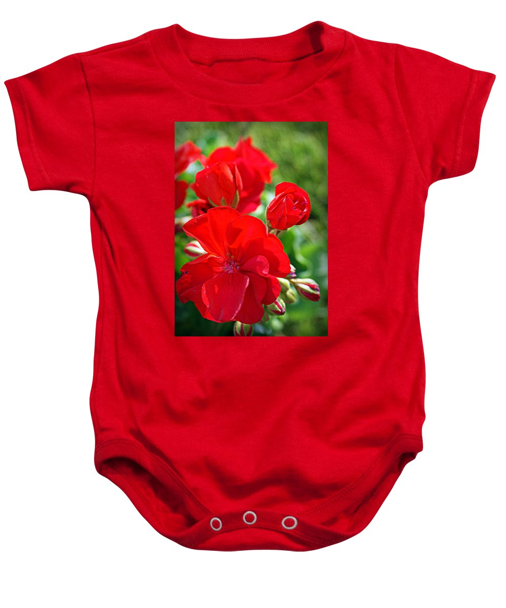 Red Baby Onesie featuring the photograph Geraniums by Cricket Hackmann