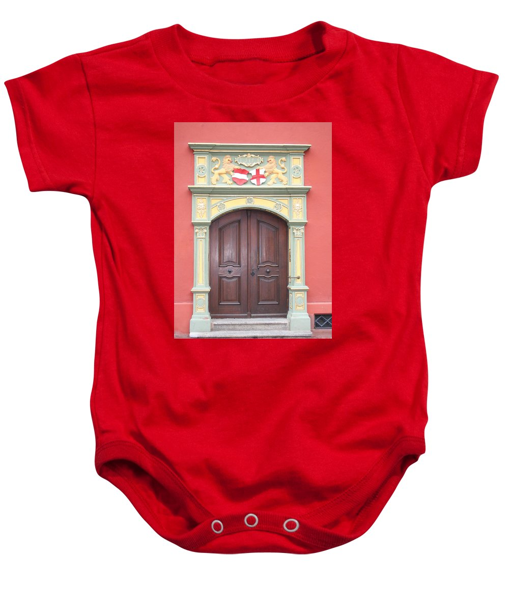 Door Baby Onesie featuring the photograph Old Door And Emblem by Christiane Schulze Art And Photography
