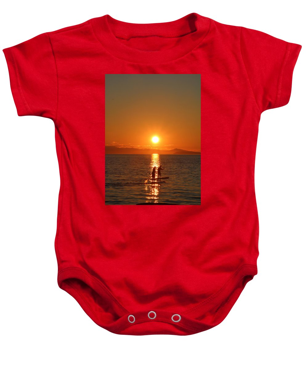Paddle Boarders Baby Onesie featuring the photograph Paddle Boarders by Brian Sereda