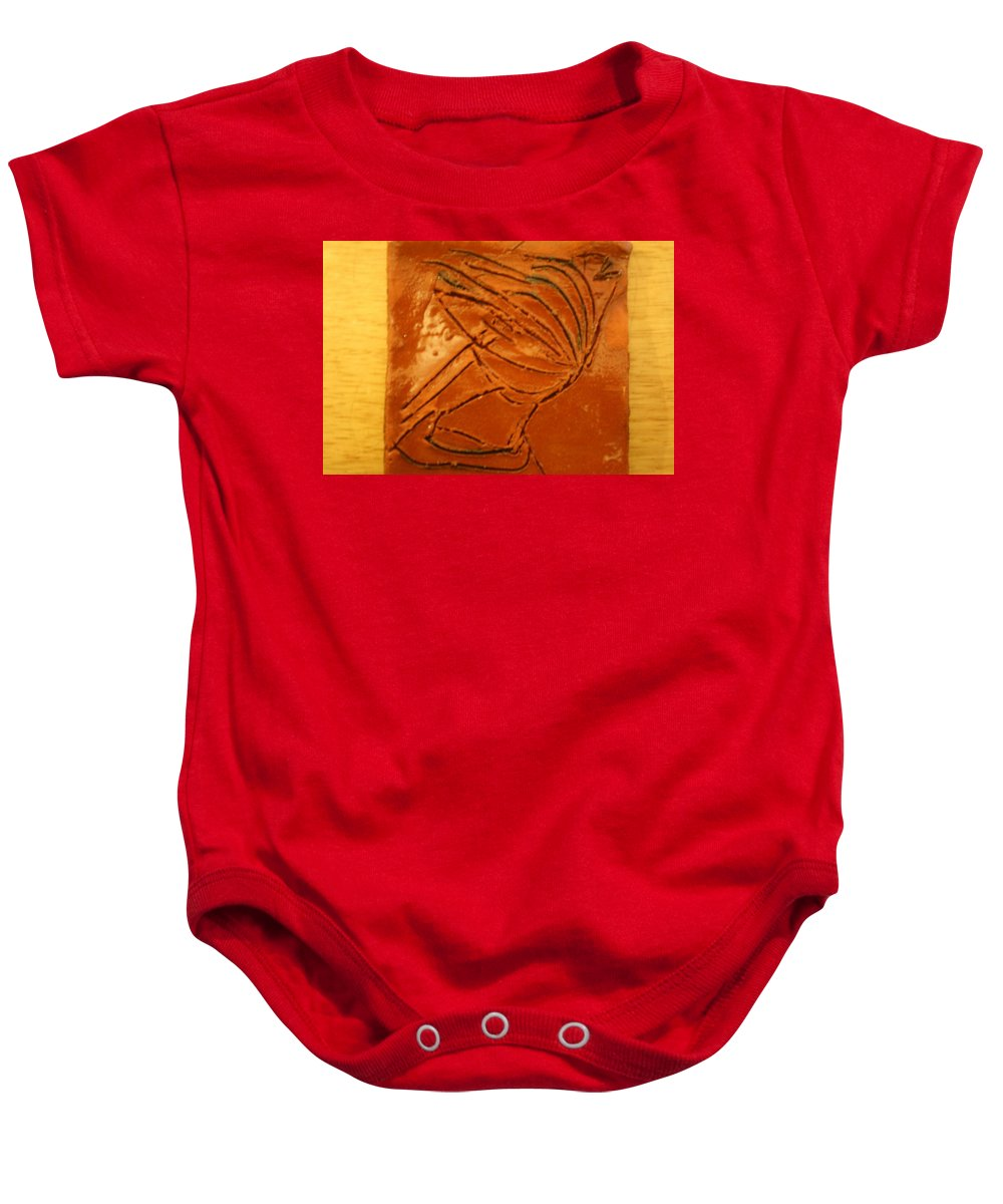 Jesus Baby Onesie featuring the ceramic art Pure Joy - Tile by Gloria Ssali