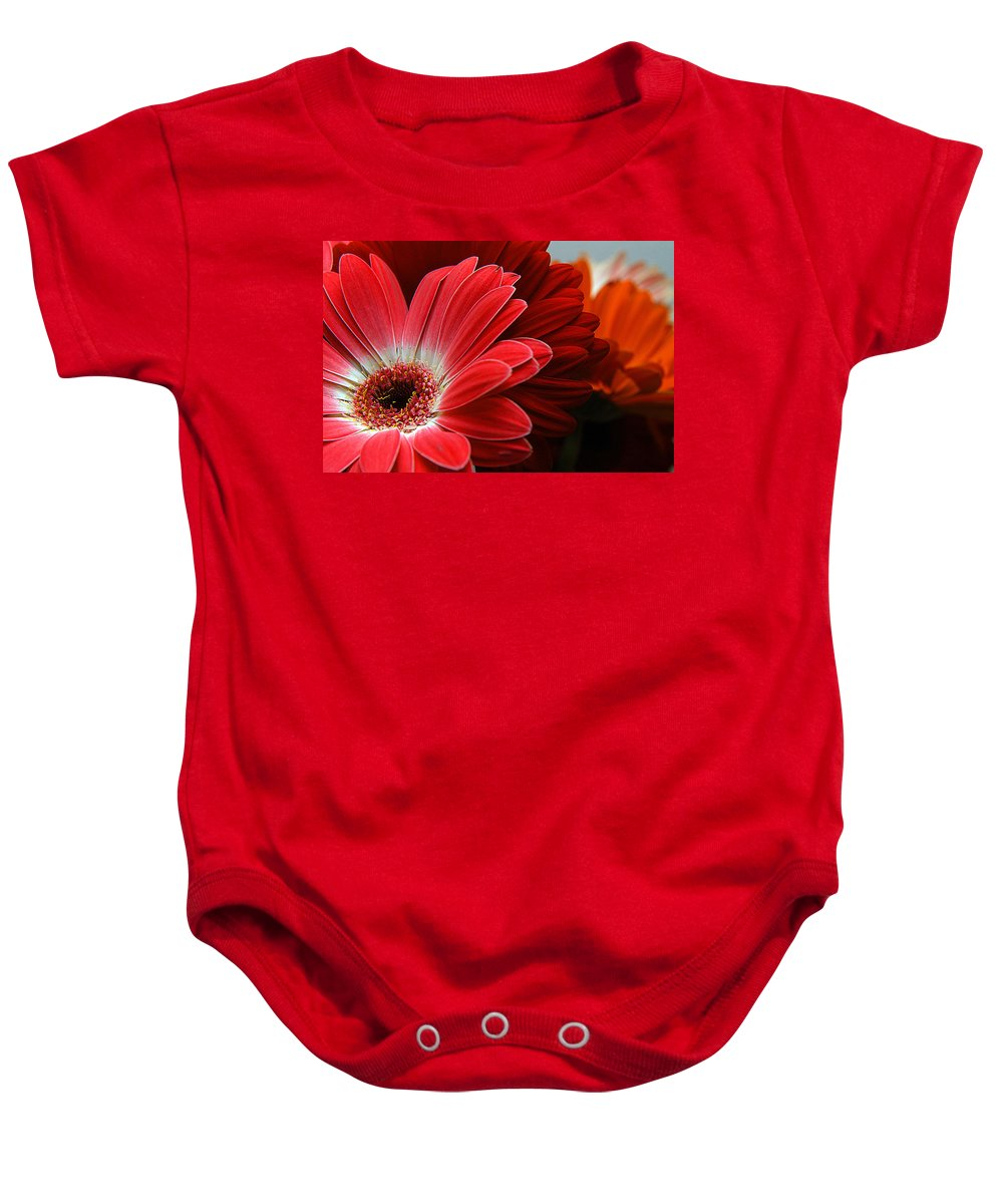 Clay Baby Onesie featuring the photograph Red And Orange Florals by Clayton Bruster