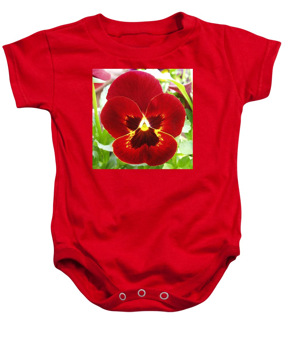 Red Baby Onesie featuring the photograph Red Pansy by Nancy Mueller