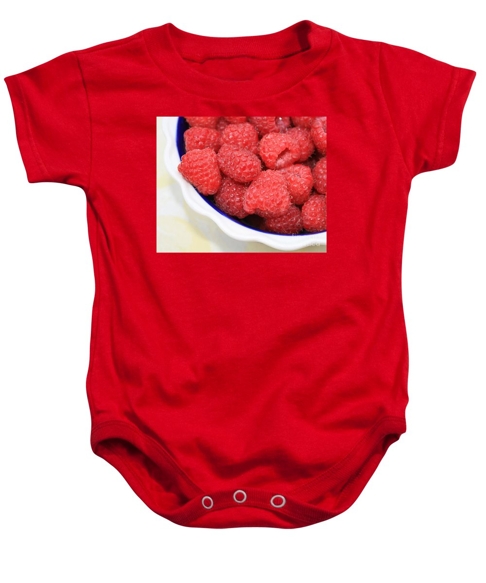 Baby Onesie featuring the photograph Side View Of Rasberries In Blue Bowl by Carol Groenen