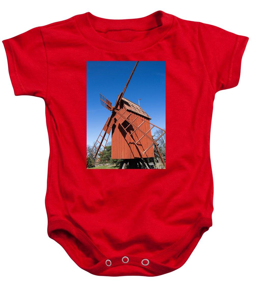 Skansen Baby Onesie featuring the photograph Skansen Windmill by Suzanne Luft