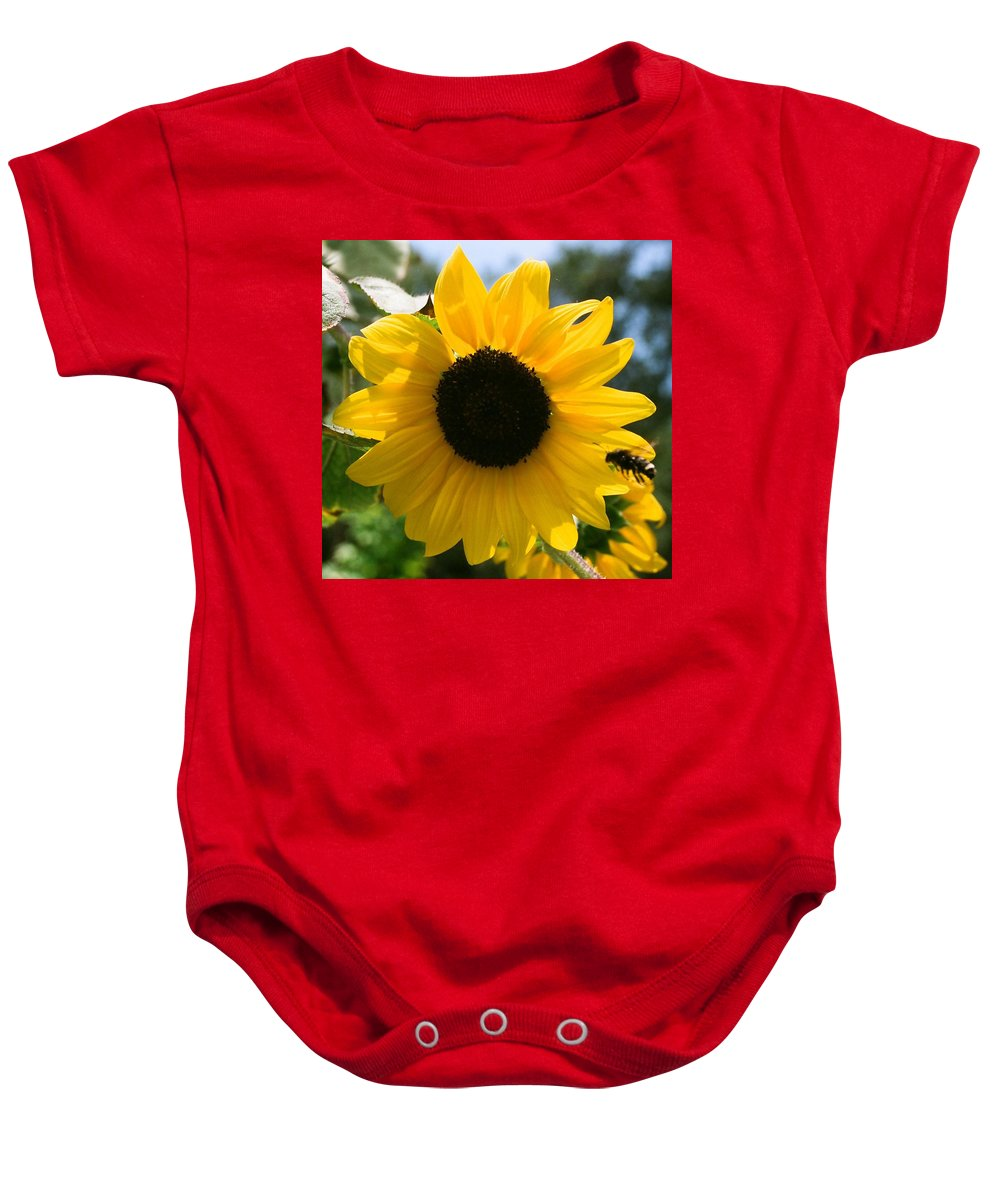 Flower Baby Onesie featuring the photograph Sunflower With Bee by Dean Triolo