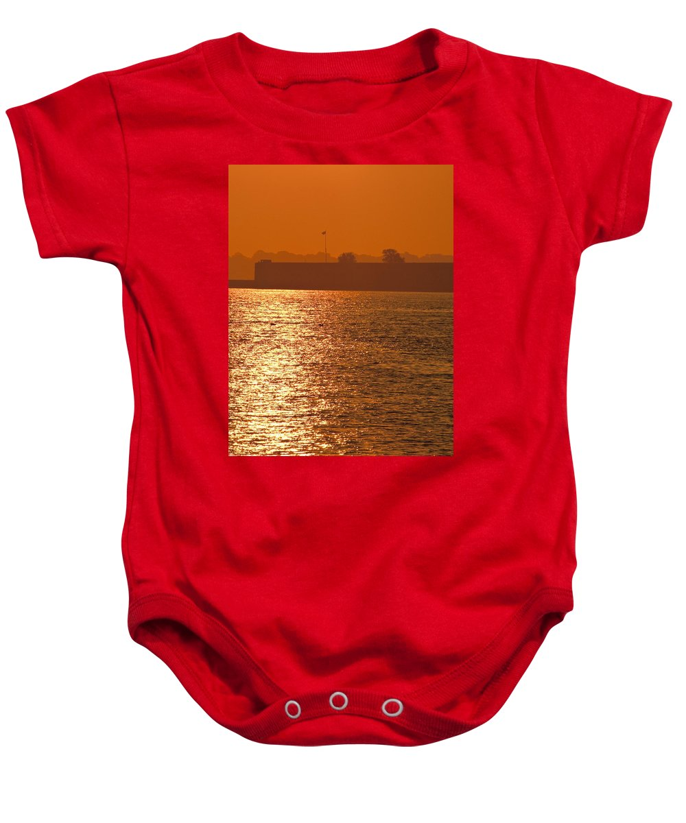 Sunrise Baby Onesie featuring the photograph Sunrise Ft Adams by Steven Natanson