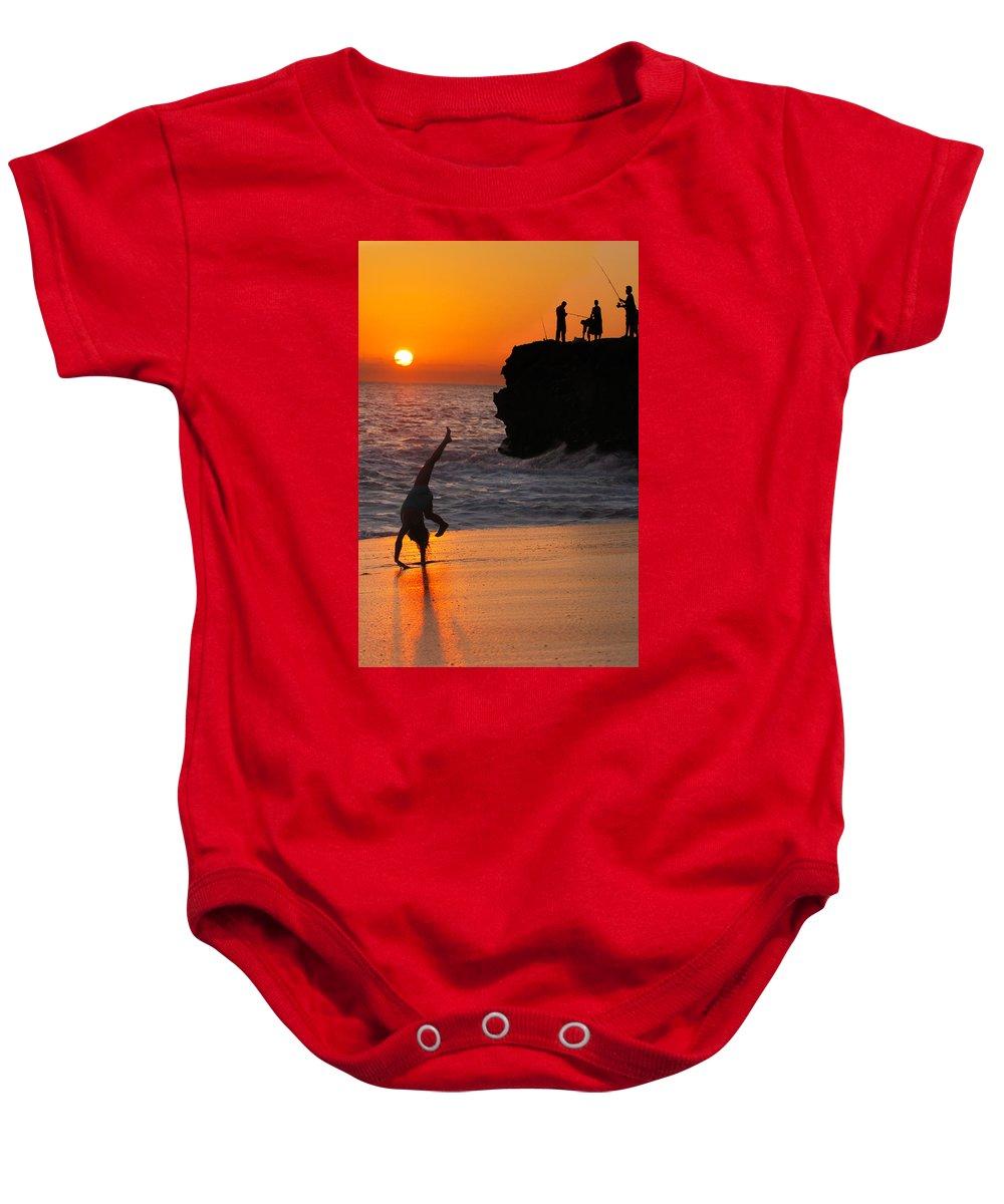 Beach Baby Onesie featuring the photograph Sunset Cartwheel by Jill Reger