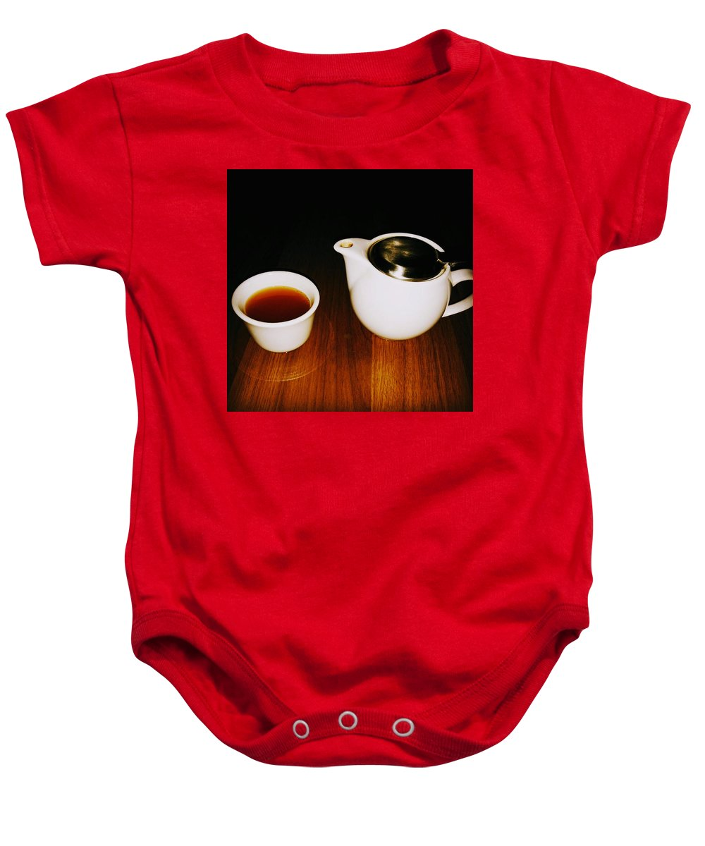Tea Lovers Baby Onesie featuring the pyrography Tea-juana by Albab Ahmed