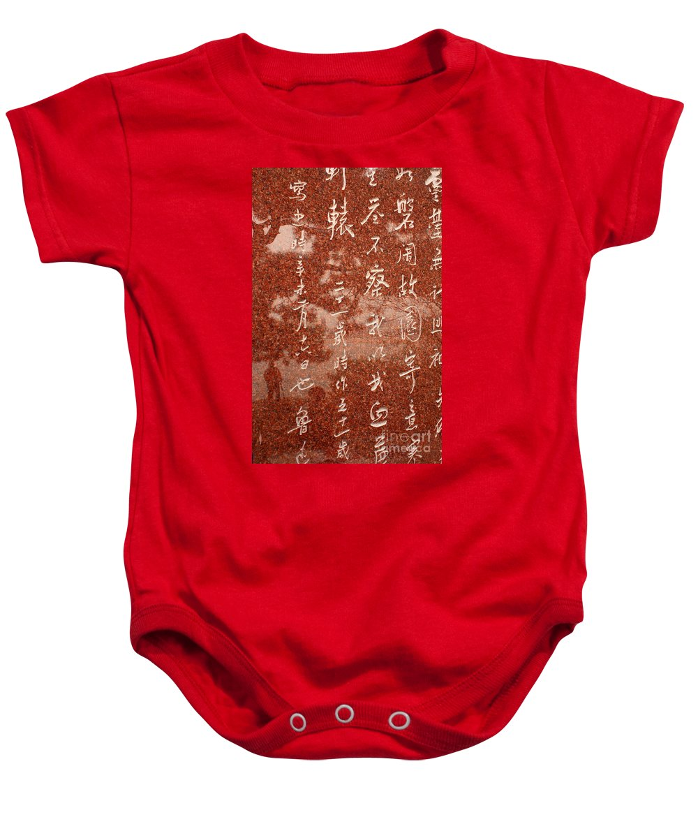 Baby Onesie featuring the photograph The Writings Of Lu Xun With Reflection Of Man by Carol Groenen