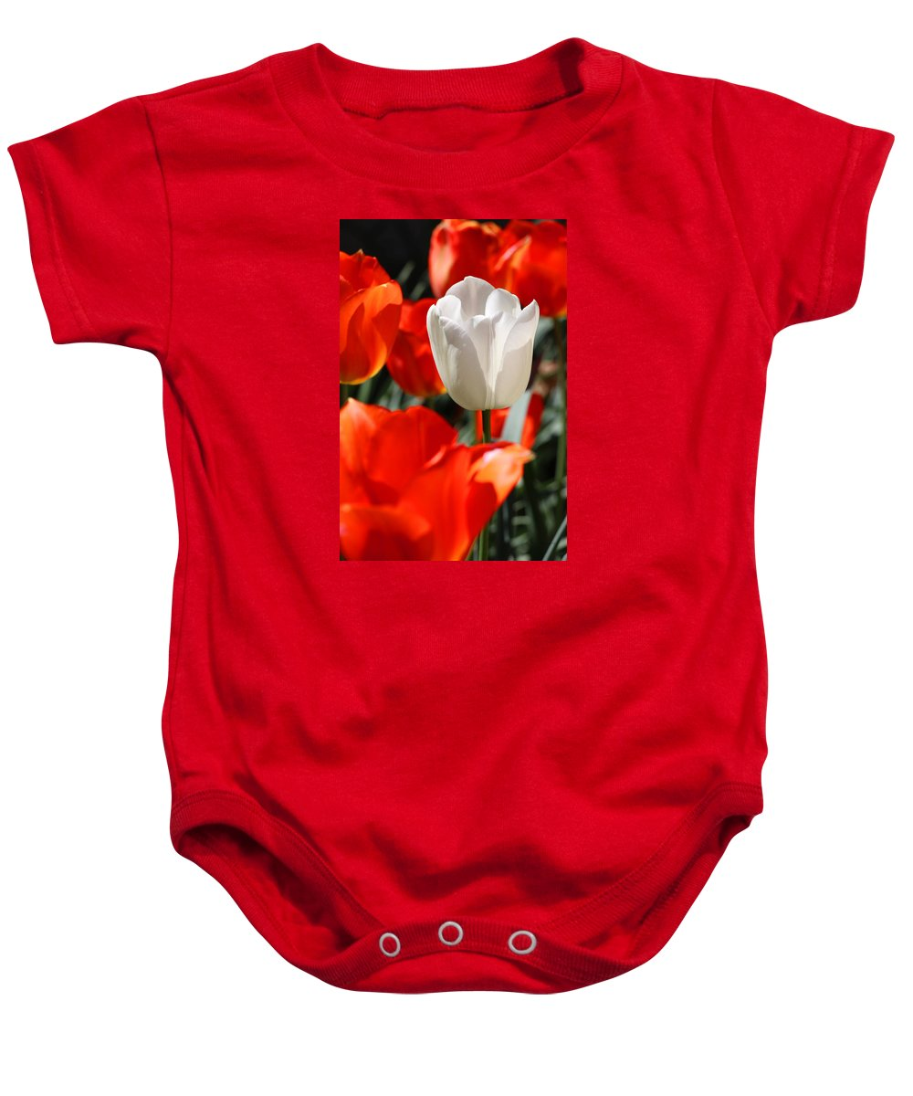 Spring Baby Onesie featuring the photograph Unlike by Iryna Goodall