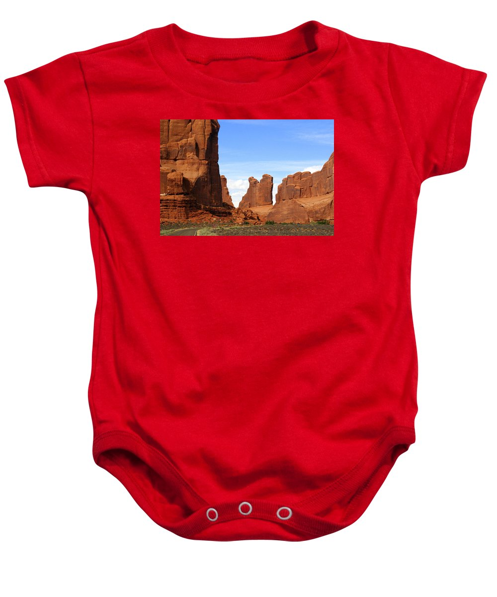 Southwest Art Baby Onesie featuring the photograph Wall Street by Marty Koch