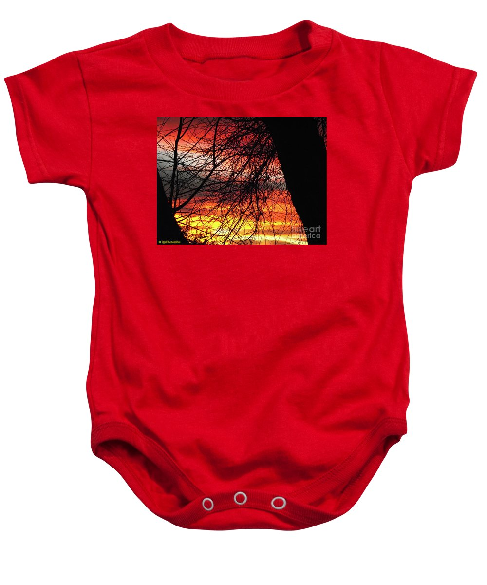 Arizona Sunset Baby Onesie featuring the photograph Arizona Sunset Through Branches by Darryl Treon