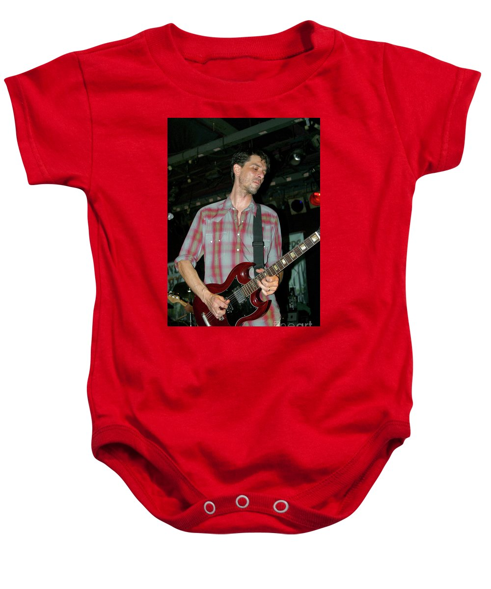 Drive By Truckers Baby Onesie featuring the photograph Drive By Truckers Guitarist Mike Cooley by Concert Photos