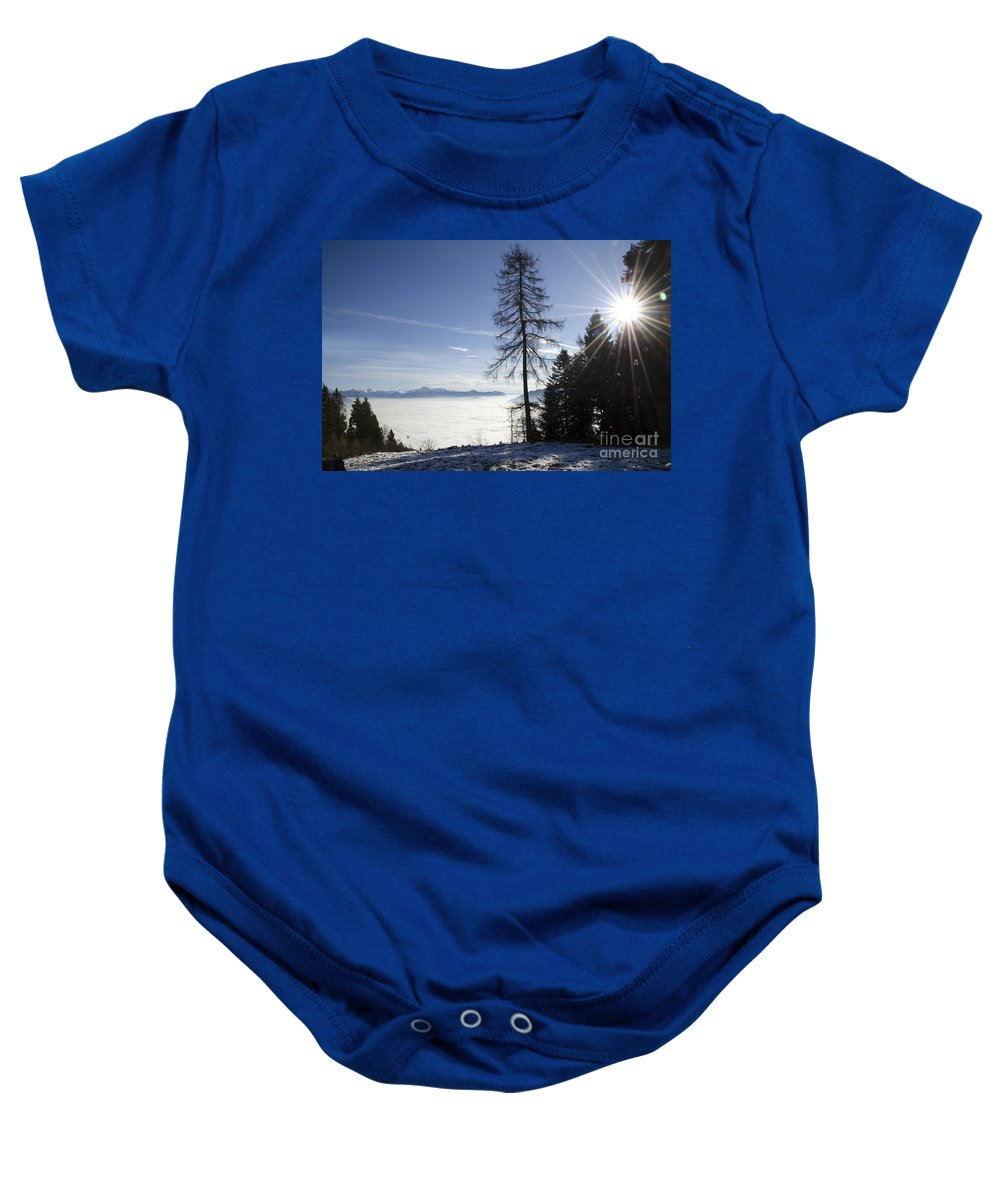 Sea Of Fog Baby Onesie featuring the photograph Sea Of Fog Over An Alpine Lake by Mats Silvan