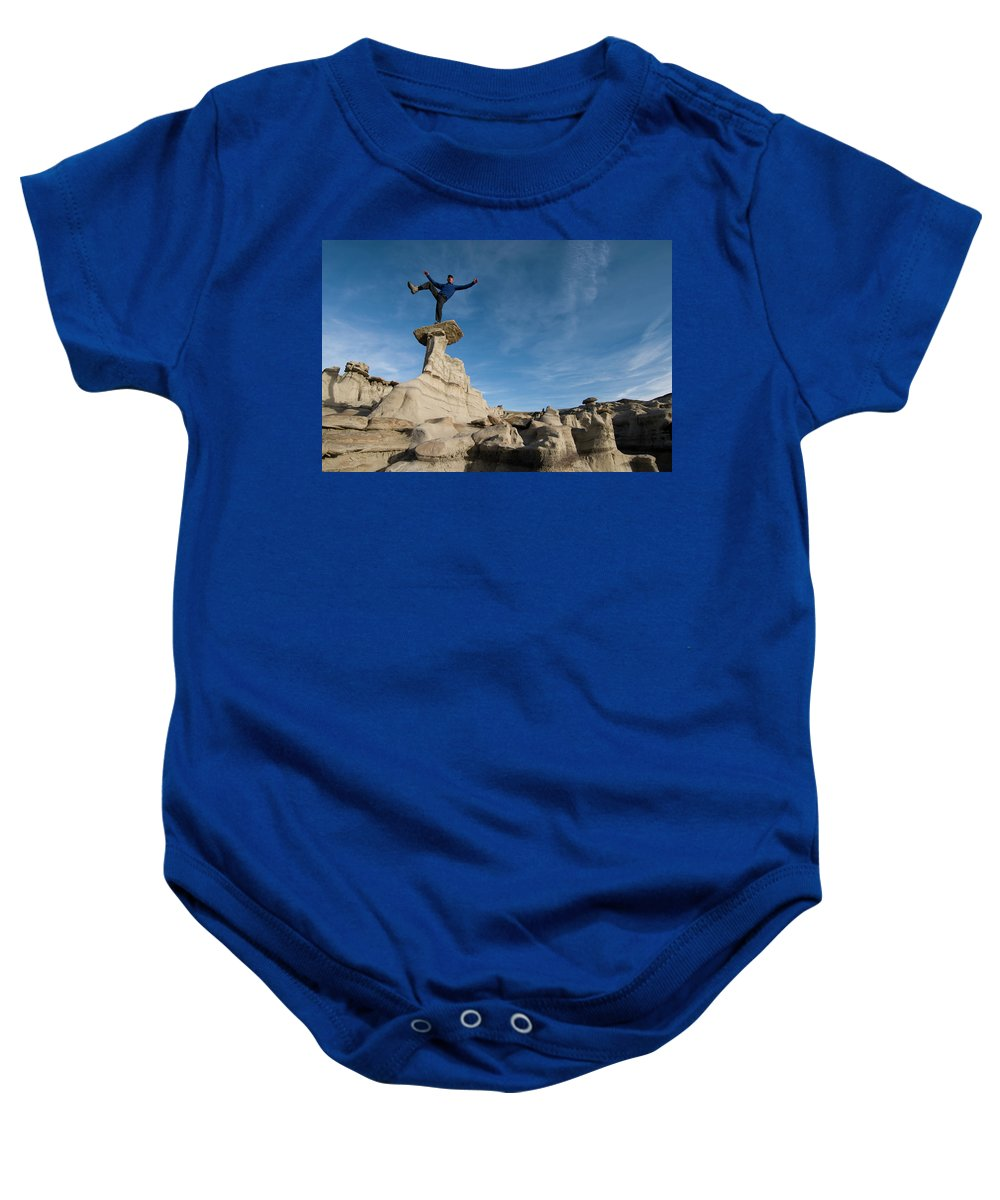 45-49 Years Baby Onesie featuring the photograph A Man Hiking And Exploring The Complex by Kennan Harvey