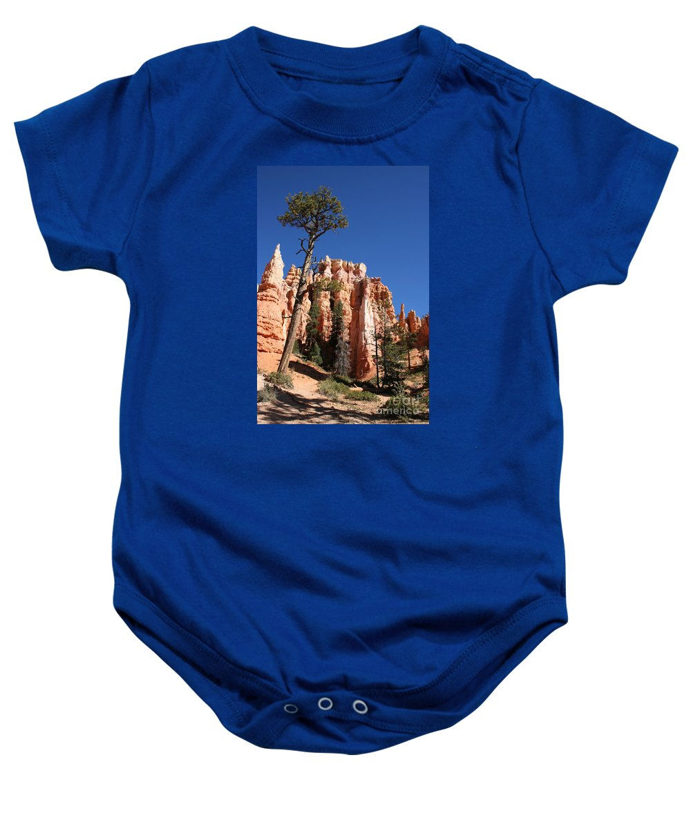 Canyon Baby Onesie featuring the photograph At The Bottom Of The Bryce Np by Christiane Schulze Art And Photography