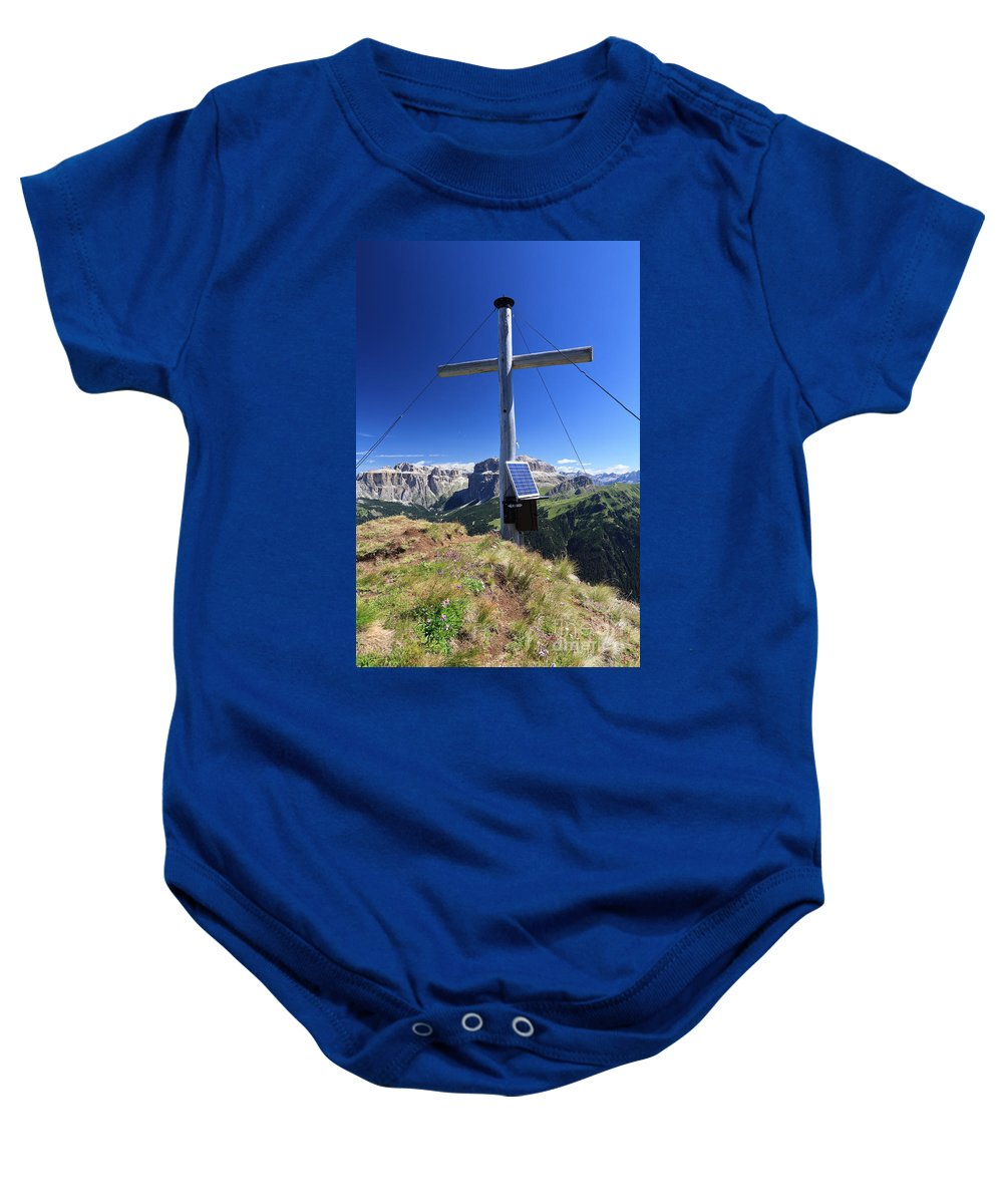 Adventure Baby Onesie featuring the photograph cross on Crepa Neigra peak by Antonio Scarpi