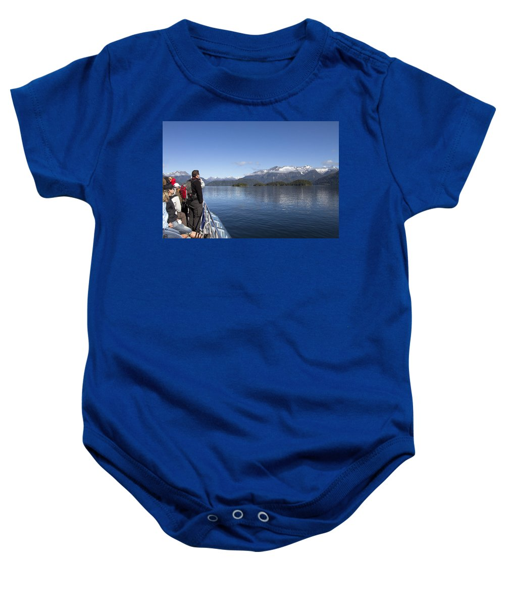 Sightseers Baby Onesie featuring the photograph Cruising Inn Doubtful Sound South Island New Zealand by Peter Lloyd