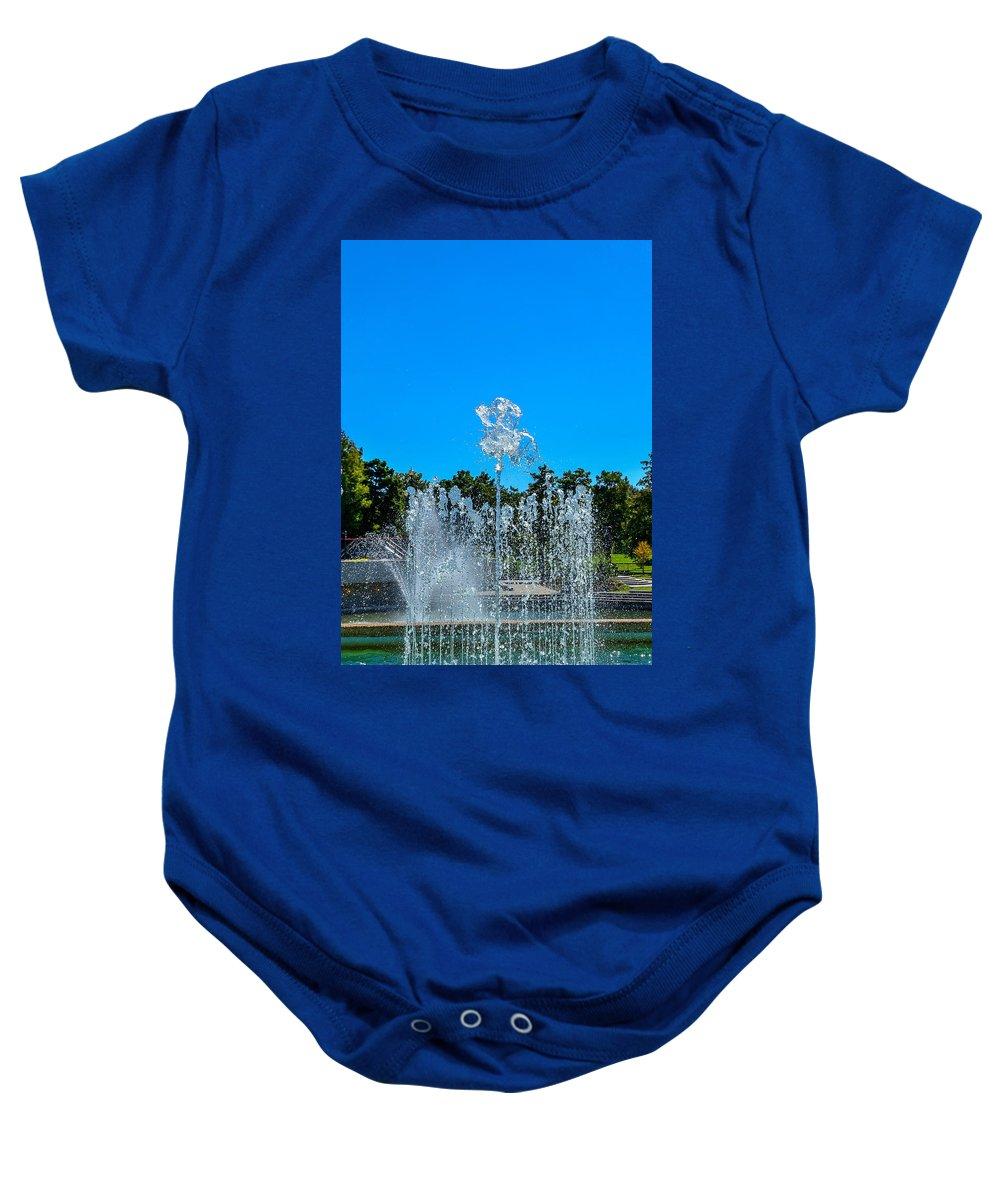 Dancing Fountain Baby Onesie featuring the photograph Dancing Fountain by Debra Martz