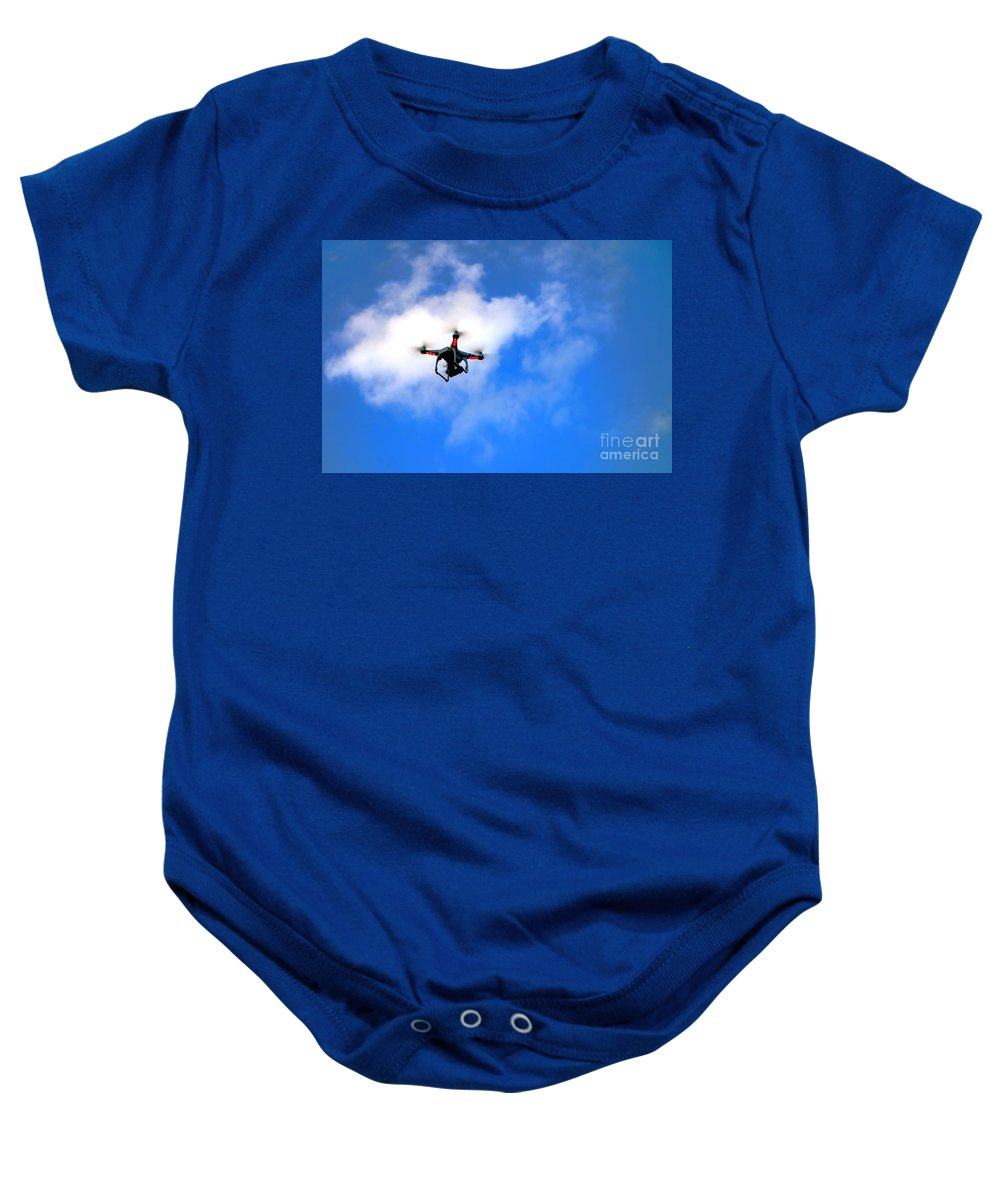 Drone Baby Onesie featuring the photograph Droning by Olivier Le Queinec