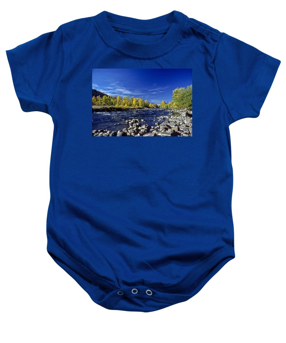 Autumn Baby Onesie featuring the photograph Fall Colors Along The Naches River by Jeff Goulden