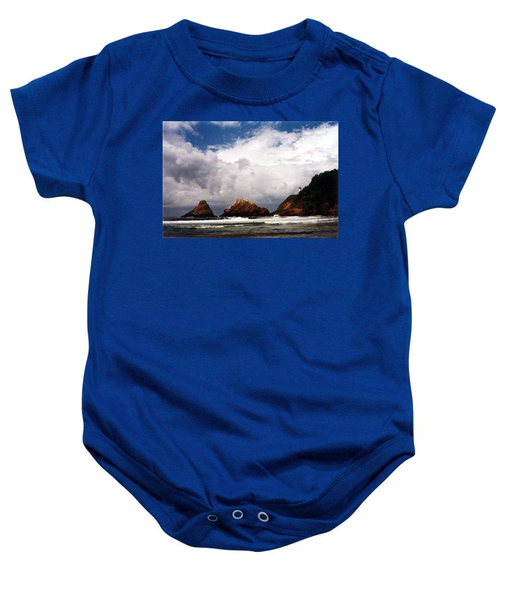 Lighthouse Baby Onesie featuring the photograph Heceta Head by Loren McNamara