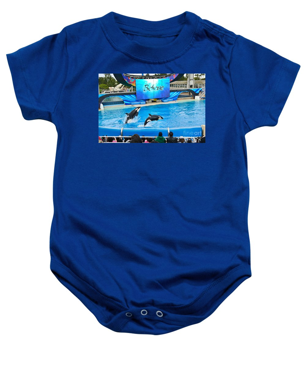 Killer Whales Baby Onesie featuring the photograph Killer Whales Perform In Shamu Stadium At Seaworld. by Jamie Pham