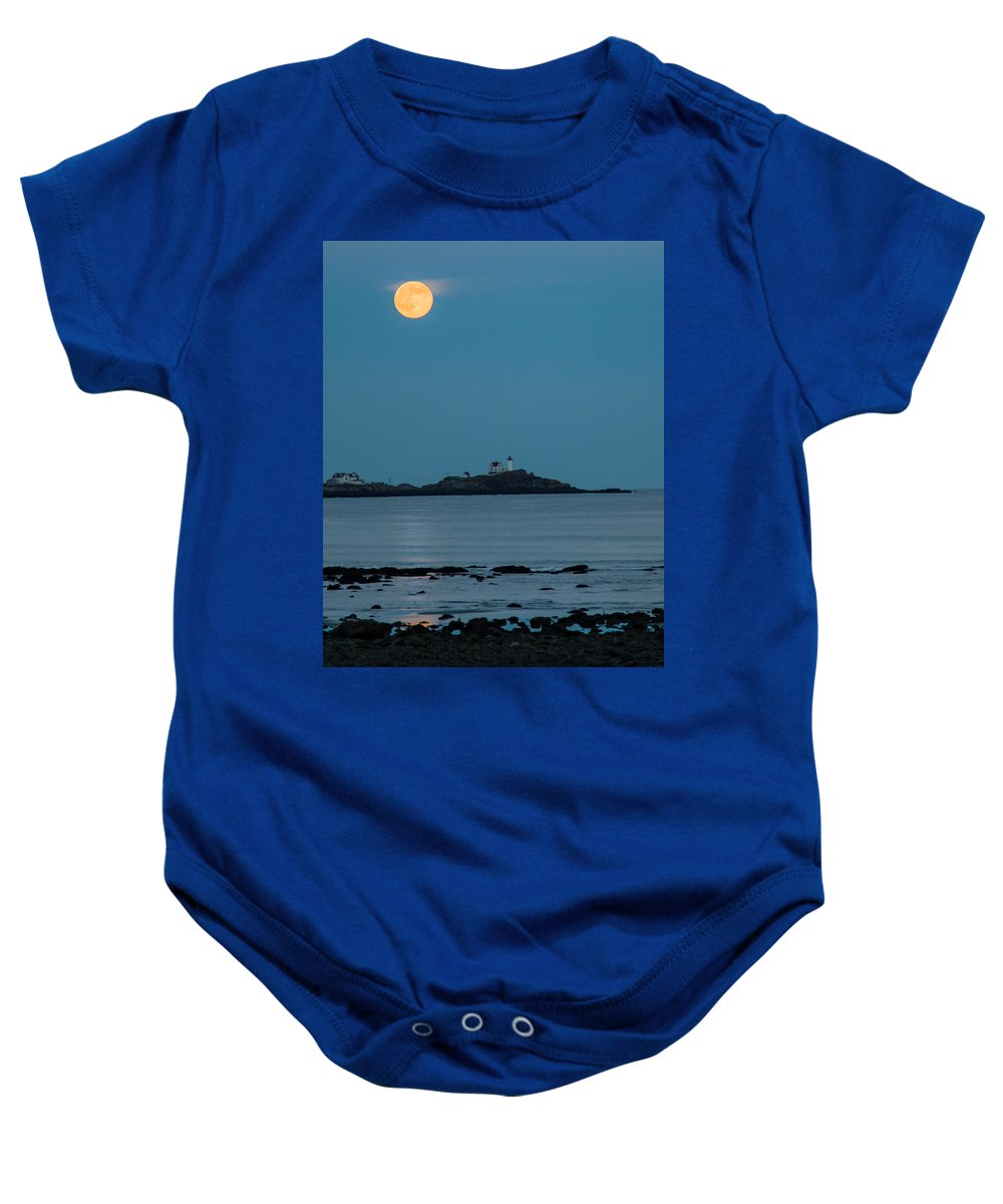 Maine Lighthouse Baby Onesie featuring the photograph Nubble Lighthouse Under Full Moon by Jeff Folger