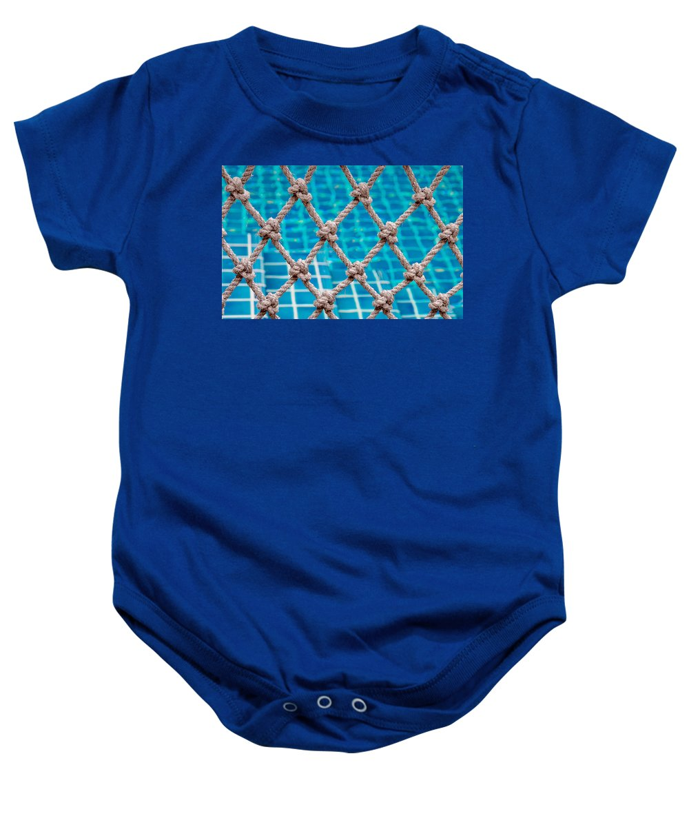 Swimming Pool Baby Onesie featuring the photograph Poolside Robe Fence by Jenny Rainbow